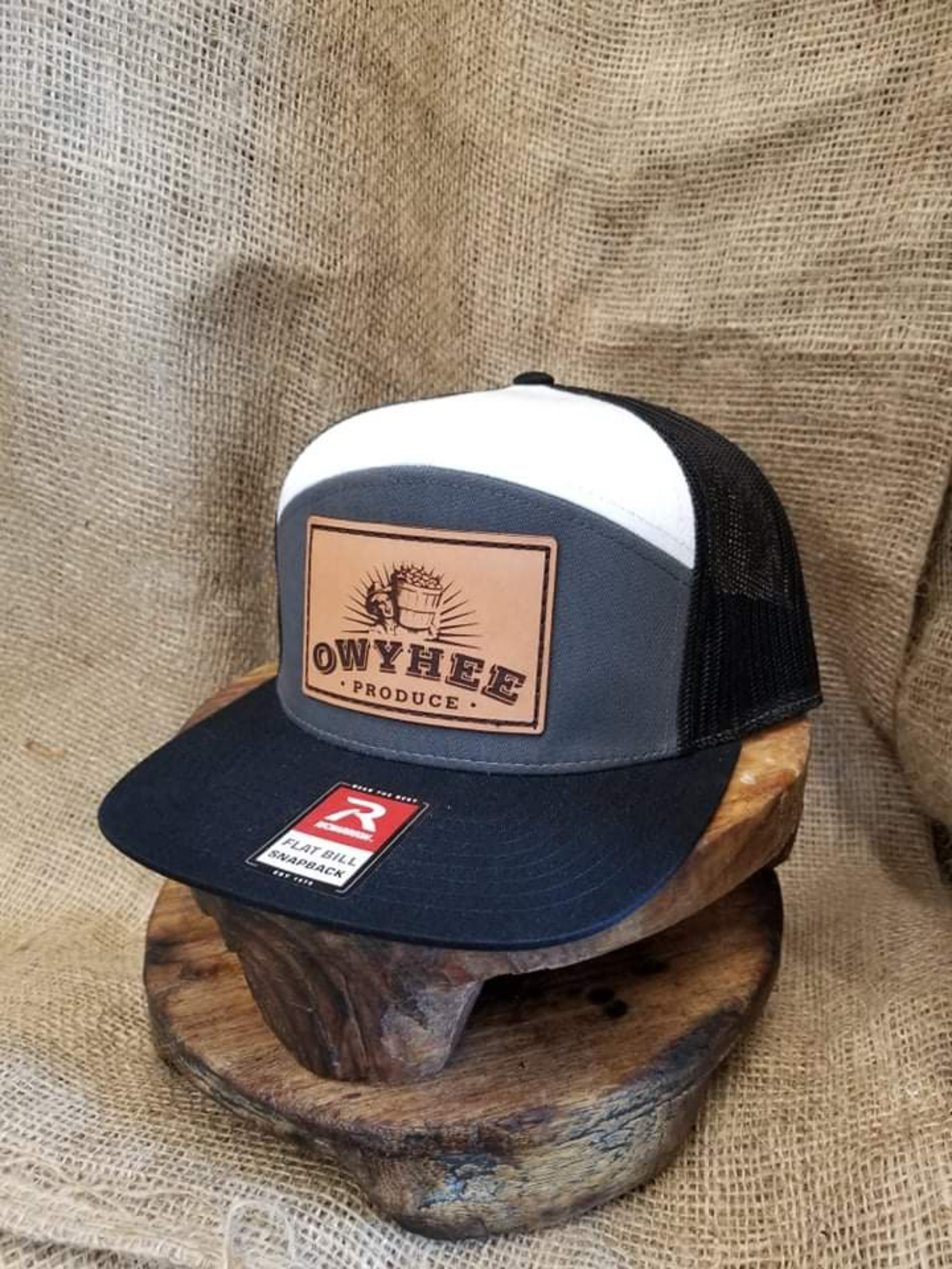 Black, white, and grey snap back with big leather Owyhee patch