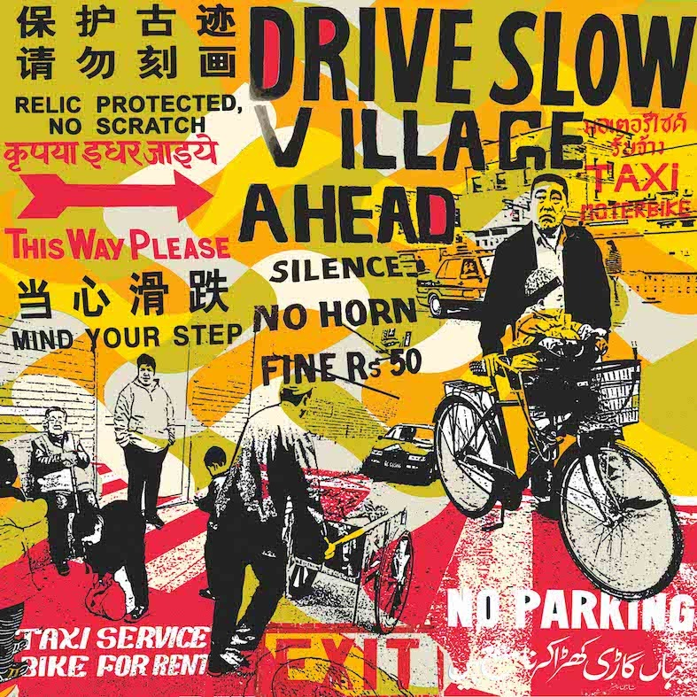 'DRIVE SLOW VILLAGE AHEAD'