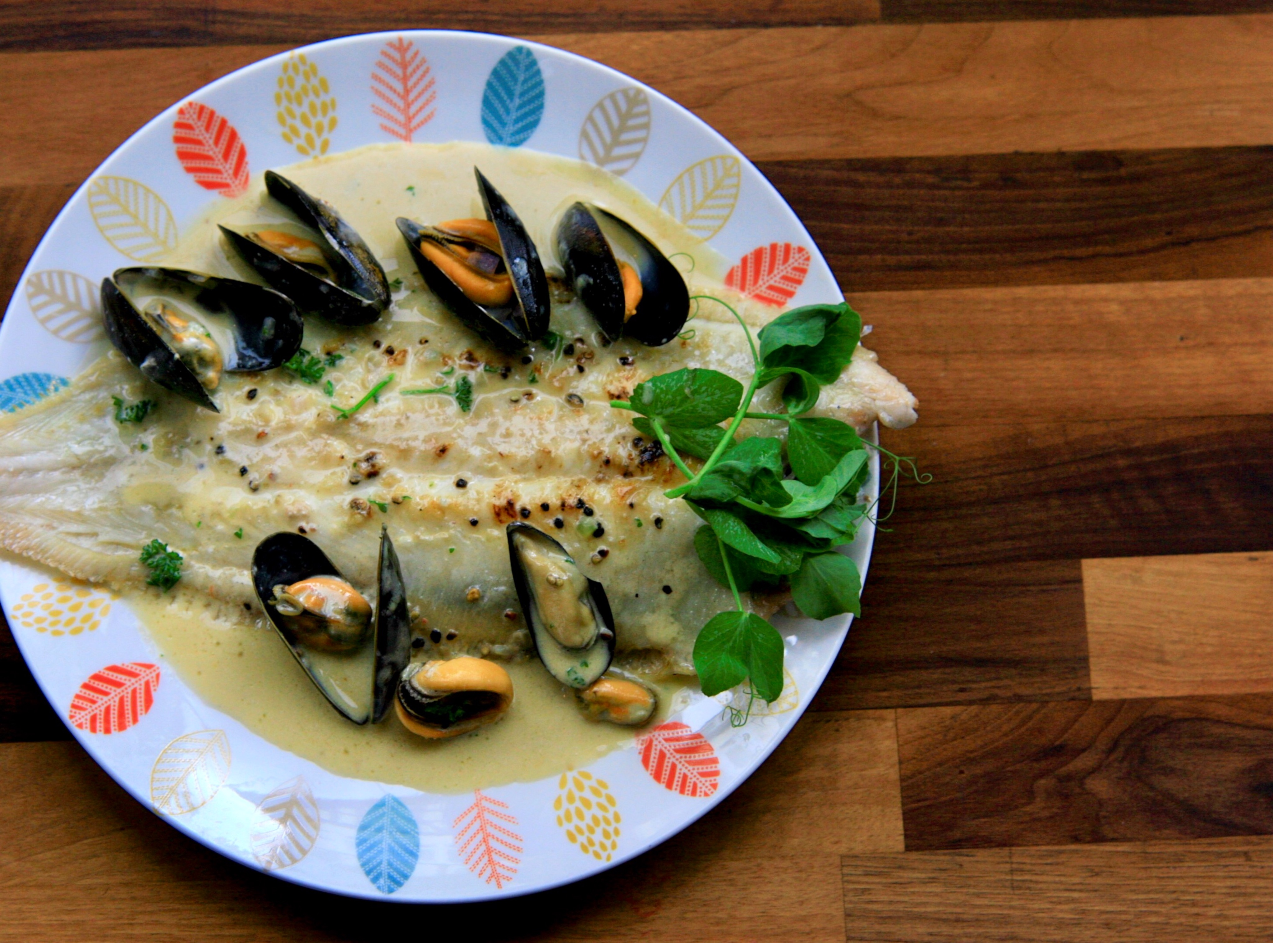 Grilled whole Sole with white wine cream sauce and mussels