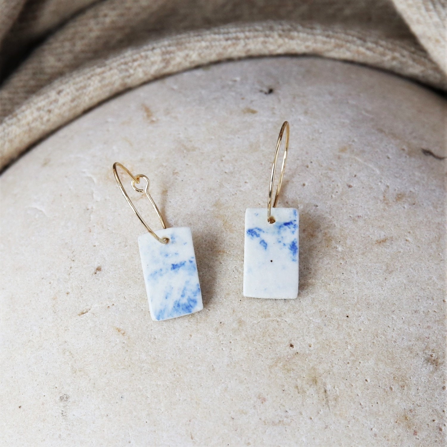 Glazed porcelain earrings on gold filled hoops by Clay Shed Studio
