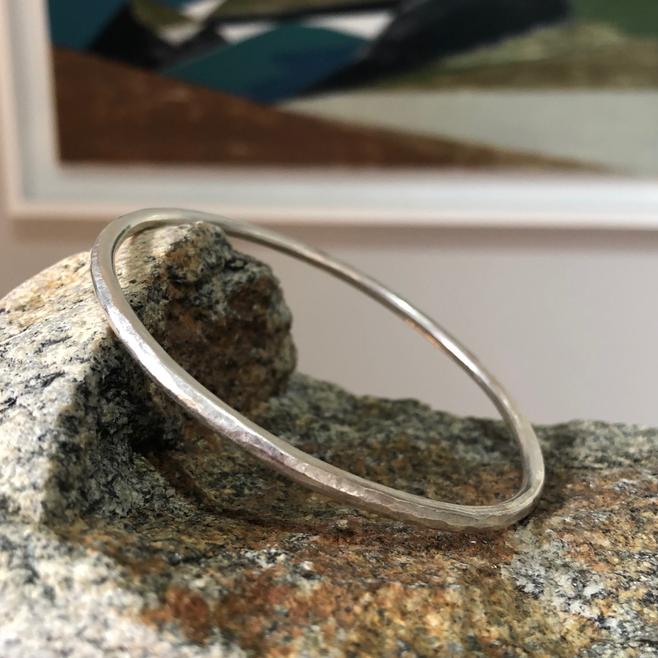 Heavy textured rounded silver bracelet by Lucy Spink