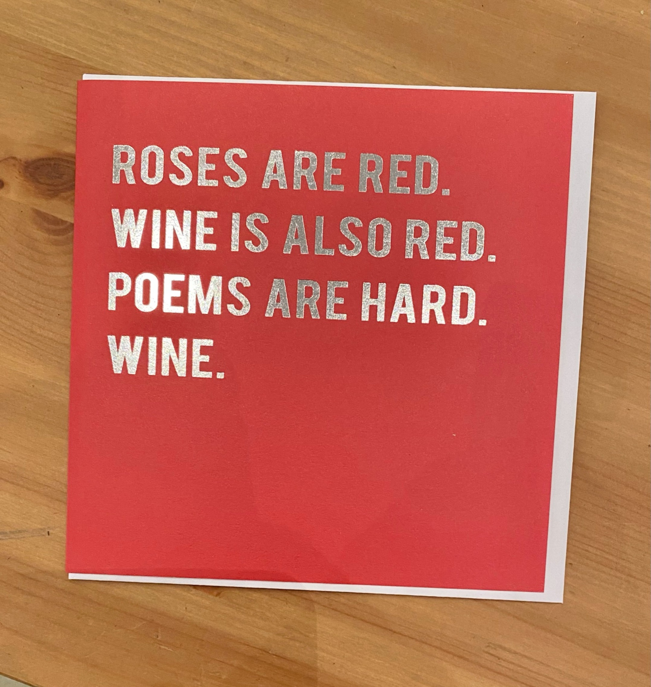 Roses are red, so is wine greeting card