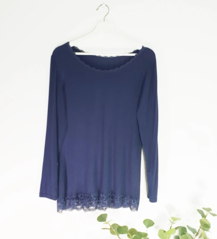 Long sleeved top with lace trim neck and hem