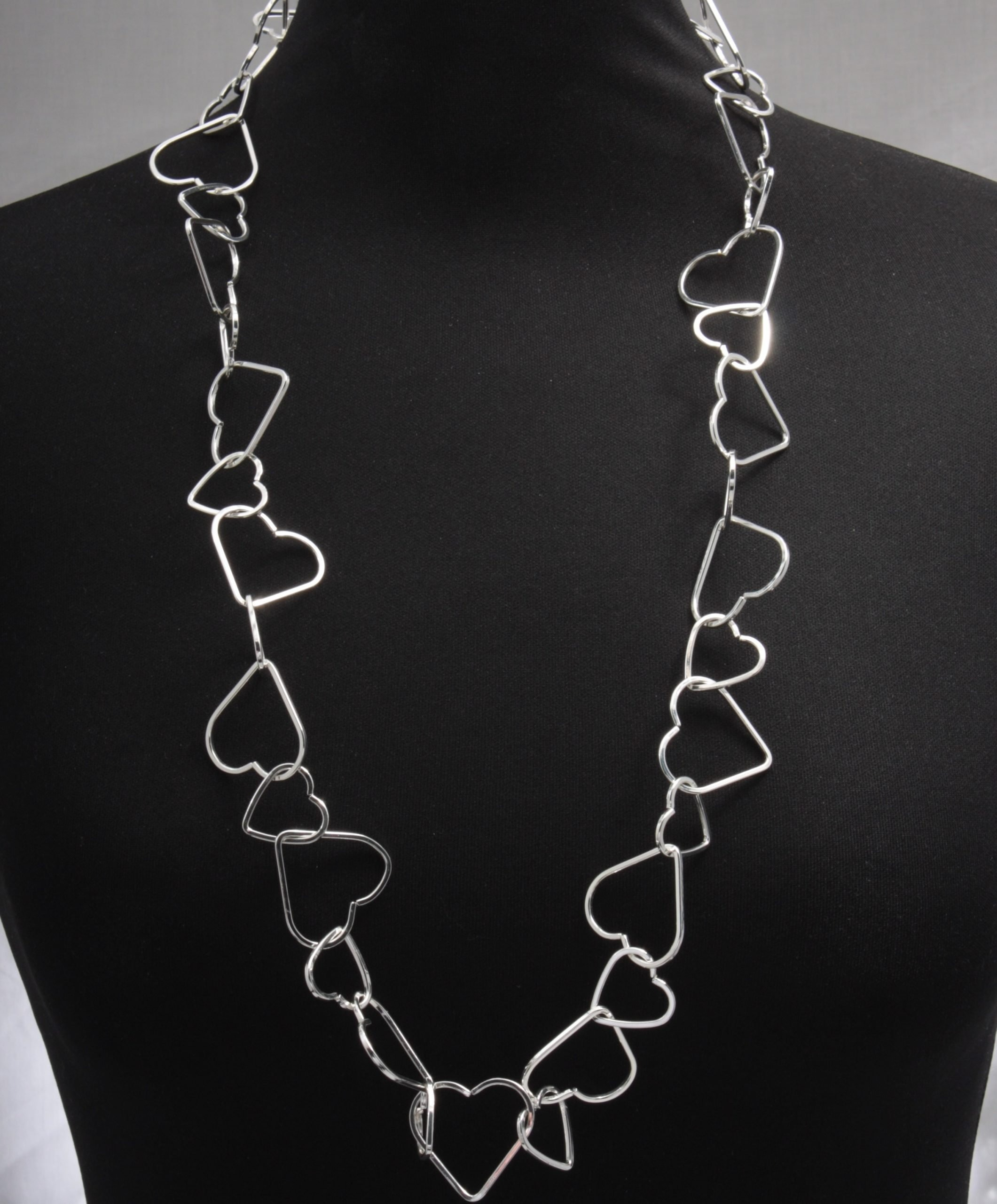 Cascading linked hearts long necklace