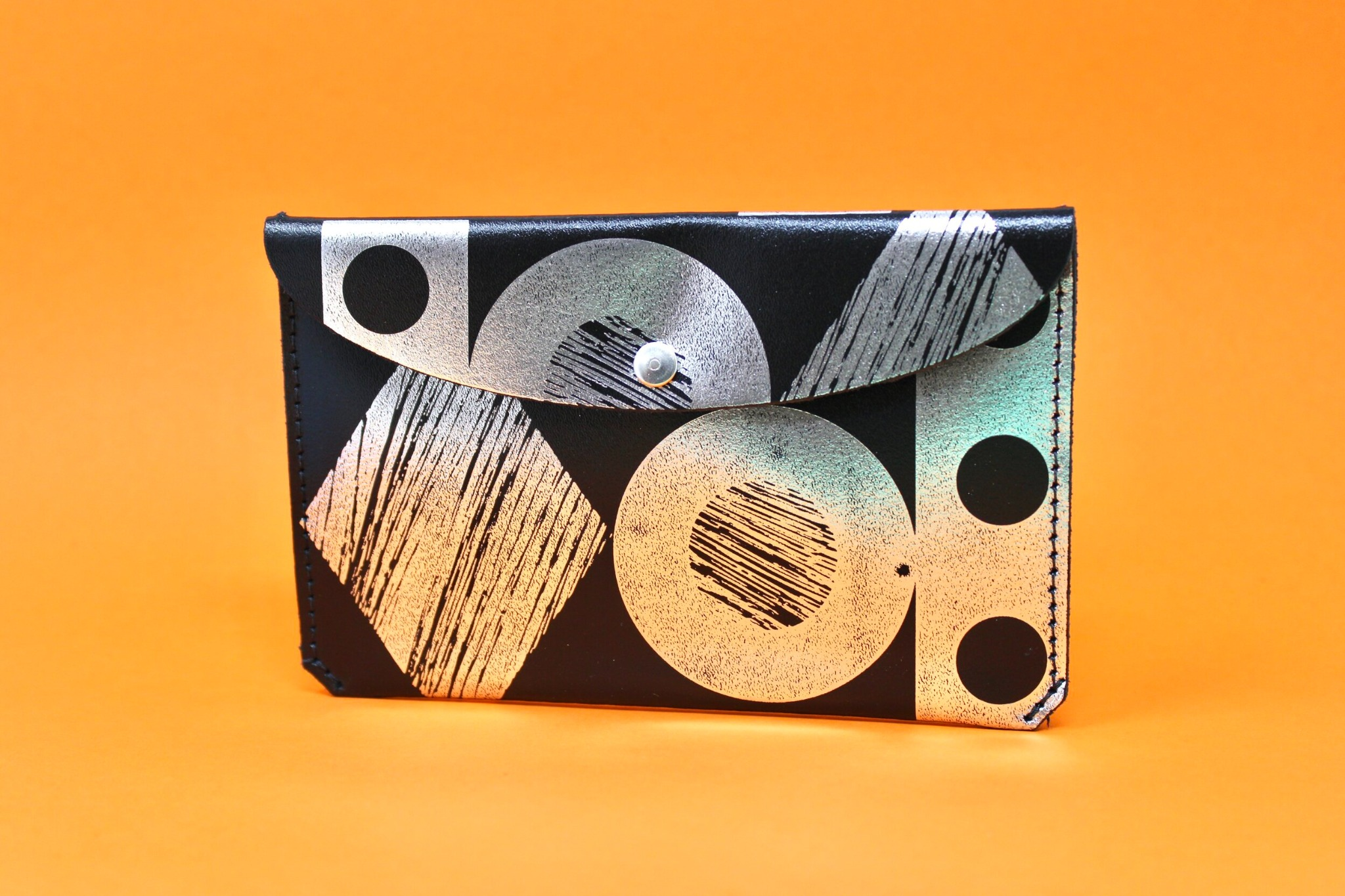'Throw some shapes' leather purse Silver/Back