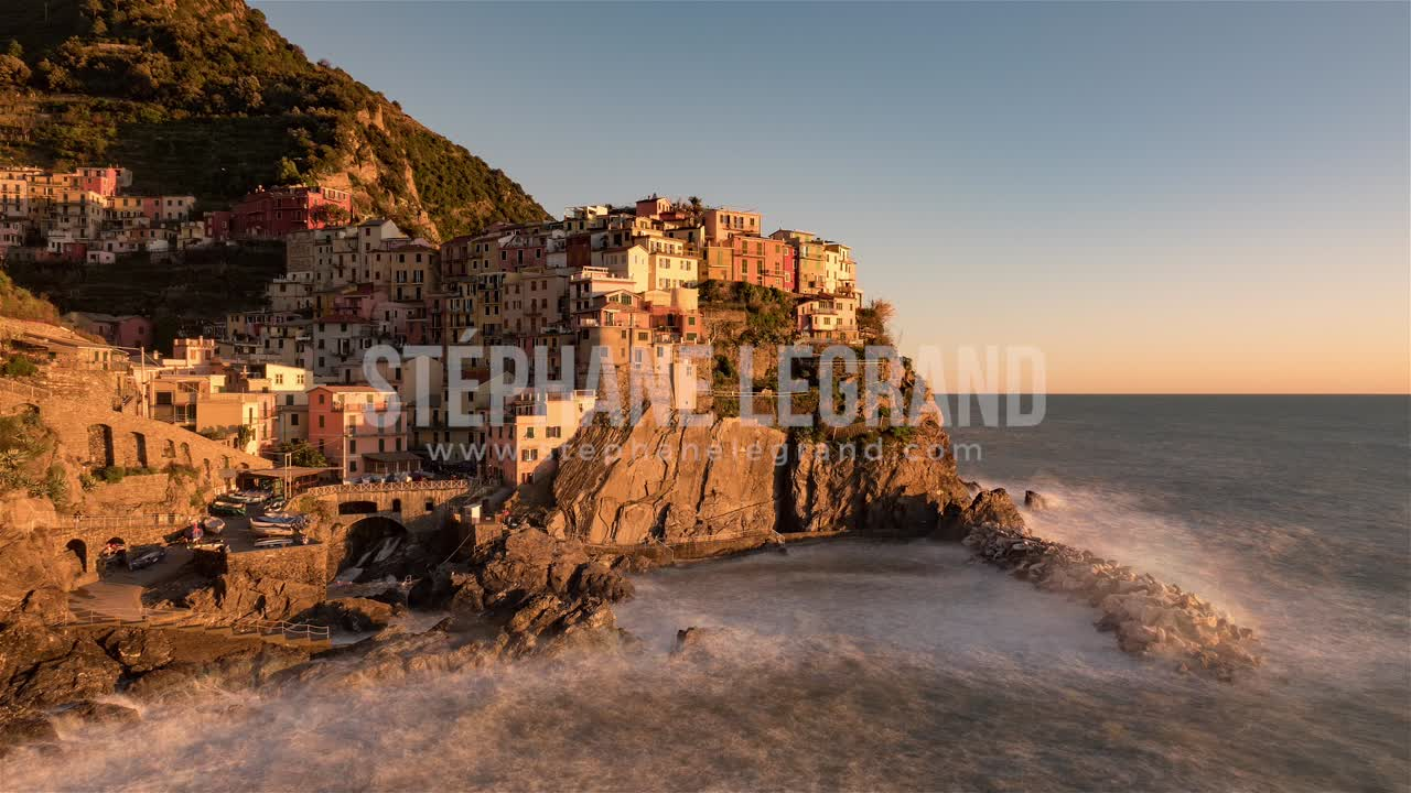 Cinque Terre, Italy, Timelapse  - The iconic village of Manarola from Day to Night