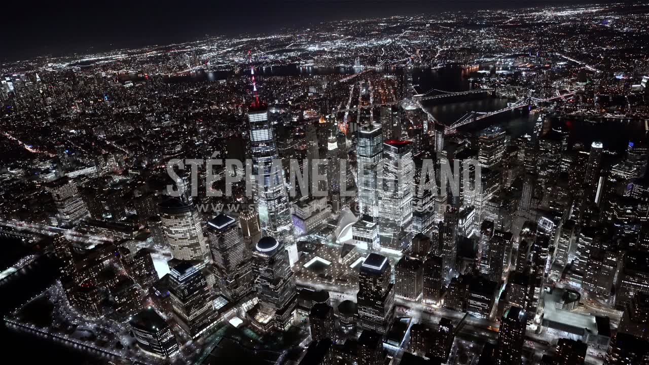 New York City, USA, Aerial  - Wide angle view of the Financial district at Night as seen from a hel