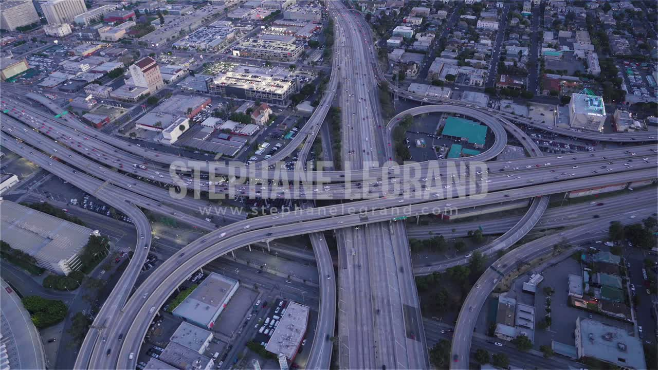 Los Angeles, USA, Aerial  - Birds eye view of The Highway 10 and 110 at dusk