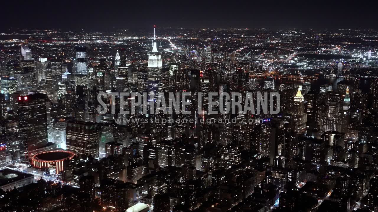 New York City , USA, Aerial  - The Midtown Manhattan at night as seen from a helicopter
