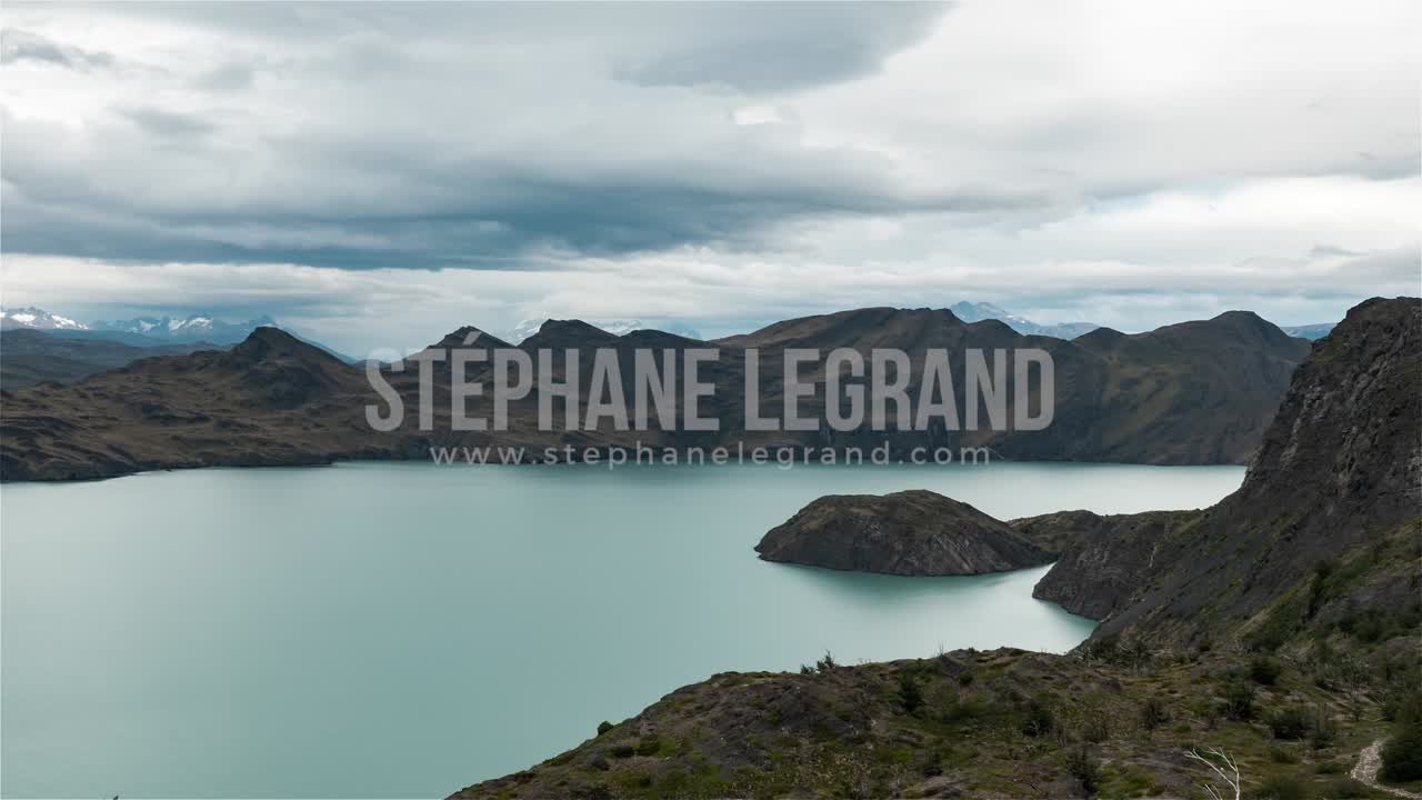 Torres del Paine, Chile, Timelapse  - The lake and the mountains during the day