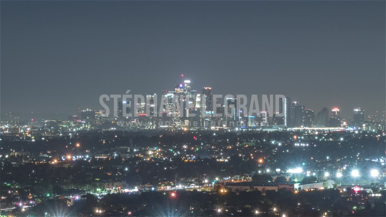 Los Angeles, USA, Timelapse  - Mid-shot of the city s skyline from night to day